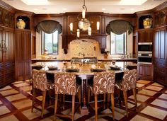 Image from http://www.homeandwoven.com/wp-content/uploads/2015/04/retro-refrigerators-Kitchen-Traditional-with-artistic-tile-Baking-Zone-bar-custom-backsplash-Custom-Cabinets-custom-floor-custom.jpg.