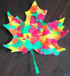 Beautiful fall leaves made from tissue paper and liquid starch.  Fall crafts for kids.