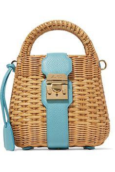 Mark Cross' 'Manray' bag works just as well in the city as it does on vacation. Expertly woven from rattan, this structured piece is trimmed with turquoise textured-leather and opens to a red interior that's sized to hold essentials like your makeup, cards and keys. Detach the shoulder strap to carry it in-hand.