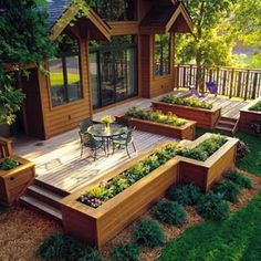 Decking with raised garden bed edging - I'd love to have this whole thing.