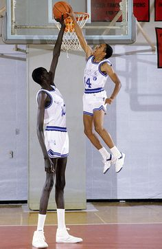 Manute Bol (left) next to Spudd Webb (right). Both NBA players known for their size, but opposites in every other way. Spudd Webb won the 1986 NBA Dunk Contest, overcoming the odds. Manute Bol was tied for tallest man ever in the NBA, and Spudd Webb was one of the shortest men ever in the NBA.