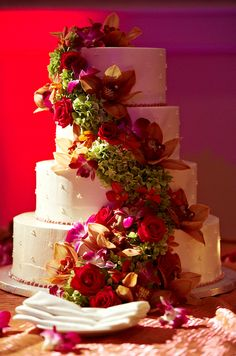 Orchid and rose wedding cake. Photo by Regeti's.