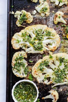 These Roasted Cauliflower Steaks are perfectly baked in the oven and loaded with the most flavorful chimichurri sauce! Flavorful, veg packed and so extra easy! #vegandinner #cauliflowersteaks #chimichurrisauce