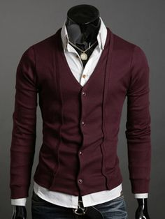 Burgundy cardigan with pleating detail.