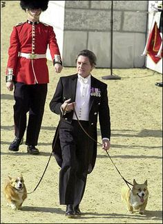 William Tallon leads the Queen Mother's corgis across London's Horse Guards Parade