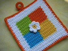 Whiskers & Wool: Four Square Crochet Potholder Pattern - FREE! The little flower in the center is a nice touch. Whiskers & Wool: Four Square Crochet Potholder Pattern - FREE! The little flower in the center is a nice touch. Crochet Potholder Patterns, Crochet Motifs, Crochet Dishcloths, Crochet Squares, Granny Squares, Crochet Kitchen, Crochet Home, Crochet Crafts, Free Crochet