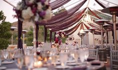 twinkle lights and purple drapes for your outdoor wedding reception #CCRwedding #countryclubreceptions #Wedding #venue #marbellacc  #WeddingVenue