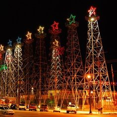 "These lighted derricks are located in Kilgore, Texas in what is called the ""World's Richest Acre."""