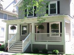 Another porch with darker wood floor and white skirting and risers. LOVE the lattice skirting; lattice must be horizontal/vertical and not angled.