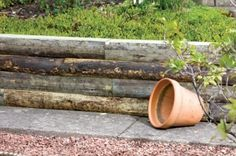 Create attractive cottage style raised beds for planting your herbs and vegetables with these lovely round rustic sleepers. #GrowYourOwnVeg