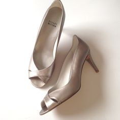 Stuart Weitzman leather pump NWOB Pewter Stuart Weitzman peep toe pumps with cross-over detailing. New without box. They've never been worn. Some minor wrinkles/miniature surface scuffs due to being stored without the box. Stuart Weitzman Shoes Heels