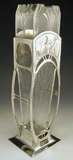 Polished pewter vase with typical art nouveau figural maiden decoration and original glass liner.  Germany, c. 1906