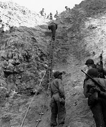 Normandy landings - Rangers scaling the wall at Pointe du Hoc.