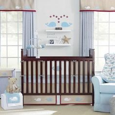 Snug Harbor is subtle and sophisticated with simple elegance. It features appliqued whales majestically moving through the ocean. Geometric circle pattern print mixes with a blend of soft blue, gray, crisp white and a touch of maroon.