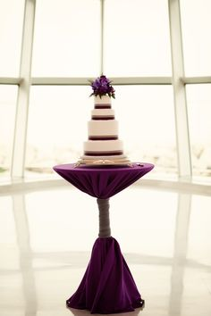 uneven wedding cake layers, purple caberet, white cake, vanda orchids.    milwaukee art museum wedding