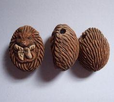 Ceramic hedgehog bead.
