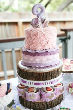 Use wood log with cake stand to create tiered cake/treats - genius!