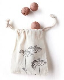 """I love the idea of a """"seed bomb"""" gift bag.  Just deploy--err, plant--seed bomb in a sunny place and wait for wild flowers.  Customize the simple recipe with local seeds."""