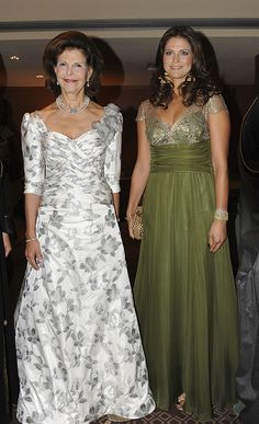 Queen Silvia and Princess Madeleine wearing elegant gowns.