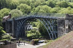 (PHOTO: Design Pics Inc/REX)  England's world records:  World's first iron bridge: Ironbridge  300 years ago the Severn Valley, in what is now Ironbridge, echoed to the sound of furnaces and toil of smelting iron, heralding the start of the industrial revolution. The world's first iron bridge, spanning the Severn in the heart of this World Heritage Site is a permanent reminder of this industrious past. Discover the story of Ironbridge at the 10 award-winning Ironbridge Gorge Museums.