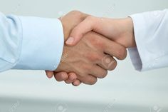 Female Medicine Doctor Shaking Hands With Male Patient ...