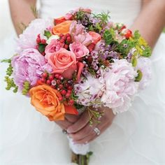 COLORS?!? ruffled mix of roses, peonies and hypericum berries.