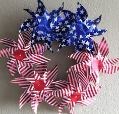 From wreaths to garlands and centerpieces, there are a hundred patriotic DIY dollar store of July decorations that won't break the bank. 4th July Crafts, Fourth Of July Decor, 4th Of July Decorations, Patriotic Crafts, 4th Of July Party, July 4th, 4th Of July Wreath, Patriotic Wreath, Patriotic Party