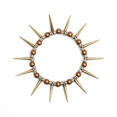 $48.00 Punk meets pretty with this unique spike bracelet from Vanessa Mooney. Silver, brass and weathered copper come together to create a signature bracelet you'll wear dressed up or dressed down.
