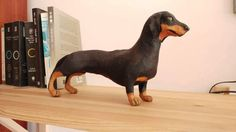 Hey, I found this really awesome Etsy listing at https://www.etsy.com/listing/507041502/dachshund-dog-sculpture-paper-mache