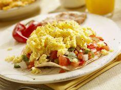 Le uova strapazzate con il pomodoro a dadini