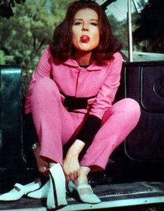 Mrs. Peel does not appreciate being interrupted while changing from stylish Mary-Janes into her kicky action boots.