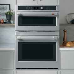 Head on shot of combo wall oven in a kitchen Oven Cleaning, Steam Cleaning, French Door Wall Oven, Electric Wall Oven, Single Oven, Oven Racks, Fresh Vegetables, Stainless Steel, Kitchen