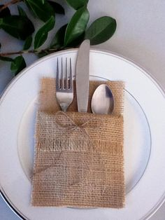 "FRENCH FARMHOUSE OR COASTAL CHIC  Your silverware nestles in these burlap pockets, adding just the right touch to your rustic table! Would also be a lovely accent for a Rustic,woodland, outdoor, eco wedding or shower.  These silverware pockets would also be a stunning  addition to your CHRISTMAS  table , year after year.: )  Machine sewn by me!  Set of 4 holders, each 4"" x 8"" Made of natural burlap, embellished with a jute bow & Fringed folded cuff.  Need a larger quantity? Contact us and we…"