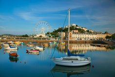 pleasure boats and a Ferris wheel at the beautiful Torquay Harbour Family Trips, Family Travel, Torquay Devon, Devon Holidays, Devon And Cornwall, Laundry Hacks, Weekend Breaks, Travel Checklist, Filming Locations