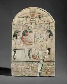 Stela of the lector priest of Amun Siamun and his mother the singer Amenhotep Period: New Kingdom Dynasty: Dynasty 18 Reign: reign of Amenhotep II–Thutmose IV Date: ca. 1420 B.C. Geography: From Egypt Medium: Limestone, paint Dimensions: H. 32.5 cm (12 13/16 in.); W. 20.5 cm (8 1/16 in.) Credit Line: Purchase, Lila Acheson Wallace Gift, 1970 Accession Number: 1970.49