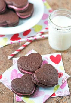 Heart-shaped chocolate cookies filled with raspberry cream cheese frosting are the perfect Valentine's Day cookie and yummy enough to eat all year!