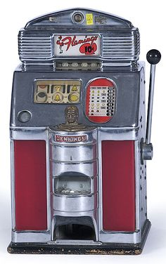 """Ca 1940s, a Jennings manufactured """"Bronze Chief"""" triple bell slot machine.  cowanauctions.com"""