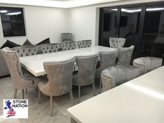 Eight dining chairs with two taller chairs at the ends of the table to create a statement. Quartz dining table, large single pedestal in matching stone. Granite Dining Table, Dining Chairs, Marble Fire Surround, Marble Furniture, Granite Worktops, Bespoke Furniture, Pedestal, Printing On Fabric, Quartz
