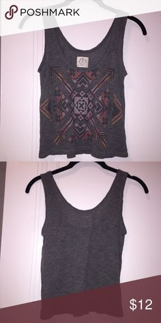 American Eagle Aztec Print Crop Top Great condition! Dark grey crop top with Aztec print in different shades of pink. It's a great summer shirt - you can dress it up or down! Please make an offer if you're interested! American Eagle Outfitters Tops Crop Tops