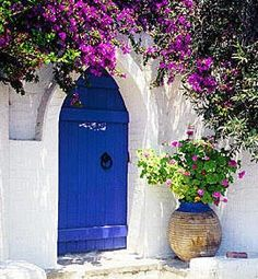 This looks like Greece.  I love the color.  Aren't the flowers beautiful?