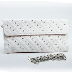 """- Made of high quality leather-like material- Fully lined interior includes inside cell phone pouch- Top flap with magnetic snap closure- Silver tone hardware- Includes detachable 22"""" chain shoulder strap- Approximate Dimension: $64.80"""