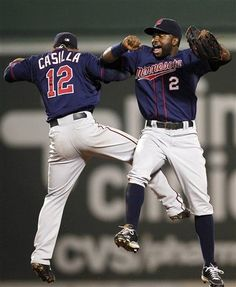 Minnesota Twins' Alexi Casilla (12) and Denard Span (2) celebrate after defeating the Boston Red Sox 6-4 in a baseball game in Boston, Saturday, Aug. 4, 2012.