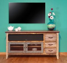 Solid distressed pine is crafted into a unique rustic TV stand entertainment center for cottage, coastal, country and traditional decors. Painted distressed finish.