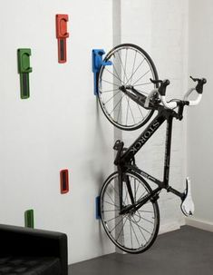 A clever, two-piece system for storing your bike inside