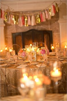 Glittery gold table numbers and table decor - For more ideas and inspiration like this, check out our website at www.theweddingbelle.net