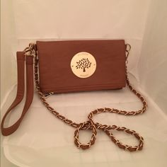 Mulberry purse Mulberry purse In great condition. Magnetic snap closure. It is one large pocket with a smaller inner zip pocket. Leather wrist strap and chain strap are both removable. Mulberry Bags