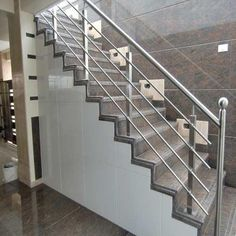Minimalist Steel Stair Railing Design Minimalist Steel Stair Railing Design, Metal and iron railings have been popular for centuries and there is no sign that they are losing that populari. Steel Railing Design, Staircase Railing Design, Balcony Railing Design, Home Stairs Design, Glass Balcony Railing, Railing Ideas, Pergola Ideas, Outdoor Stair Railing, Modern Stair Railing
