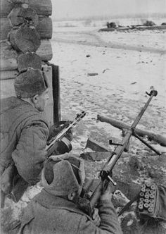 Russian soldiers during the bitter fighting in and around the village of Tula, Oct-Dec 1941. Note the PTRD-41 antitank rifle and the satchel full of anti-armor rounds. The PTRD-41 was not effective against main battle tanks but caused lethal damage to thinly armored vehicles and self-propelled artillery.