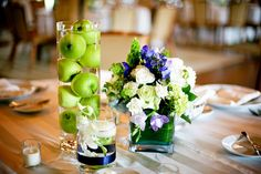 Simple and elegant centerpieces, incorporating fresh fruit in multiples.