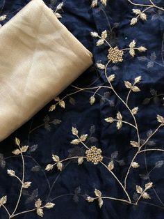 Navy blue Organza saree with golden blouse